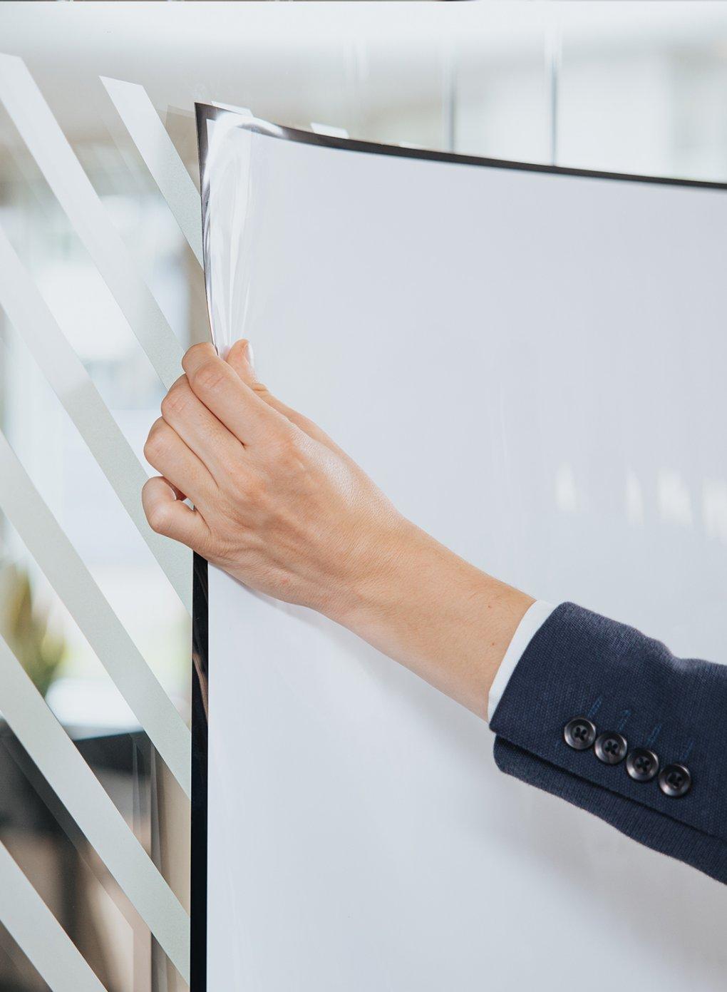 Sticking a Stick-on sheet to a glass wall